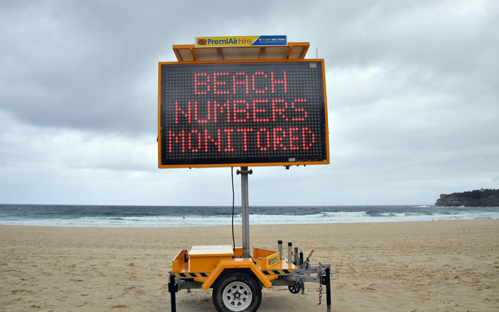 A public health order notice is seen at an almost empty Bondi Beach on Christmas Day in Sydney