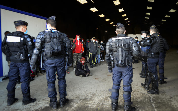 French gendarmes break up an illegal rave that around 2,500 took part in near a disused hangar in Lieuron, France..