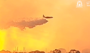 Large Air Tanker supporting firefighters at the City of Kwinana bushfire, in Perth, Western Australia.