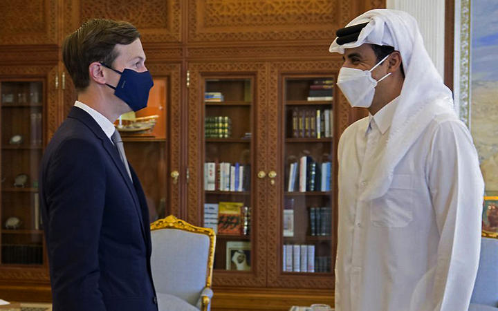 Senior advisor to US President Jared Kushner (left) meeting with Qatar's ruler Emir Sheikh Tamim bin Hamad al-Thani in the capital Doha as shown in a picture released on December 2, 2020.