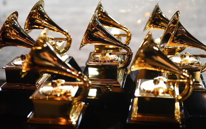 In this file photo taken on 28 January 2018, Grammy trophies sit in the press room during the 60th Annual Grammy Awards in New York.