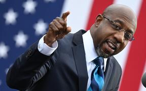 Democratic Senate candidate Reverend Raphael Warnock speaks during a campaign rally in Atlanta, Georgia on December 15, 2020.