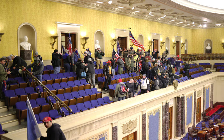 Protesters enter the Senate Chamber on January 06, 2021 in Washington, DC.