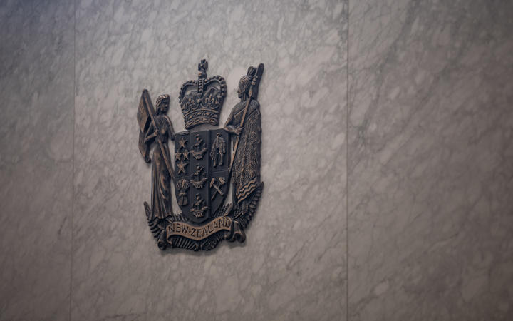 Detail of the wall behind the judge in a court room at the Manukau District Court.