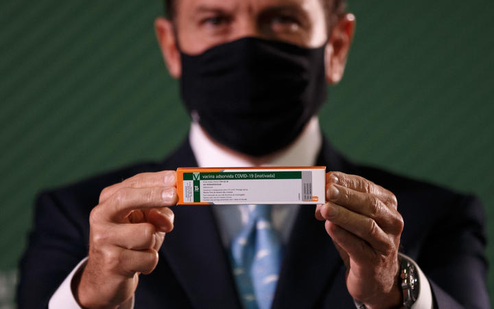 Sao Paulo Governor Joao Doria holds the CoronaVac vaccine box press conference with information about the Butantan Institute vaccine against COVID-19 (coronavirus).