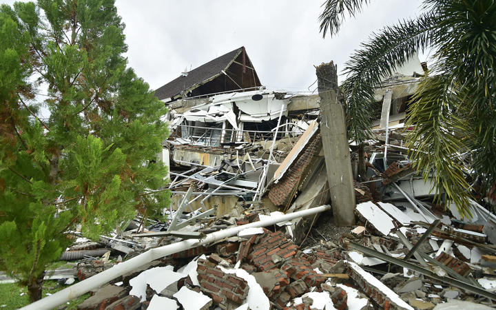 A general view shows a collapsed building in Mamuju