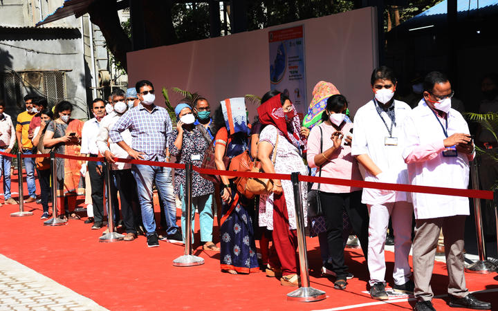Indian Health workers wait in line to receive a Covid-19 coronavirus vaccine in Mumbai, India.