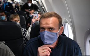 Russian opposition leader Alexei Navalny in a plane before takeoff from Germany bound for Moscow.