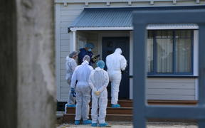 Investigators at the Taranaki home that is the focus of a double homicide inquiry.