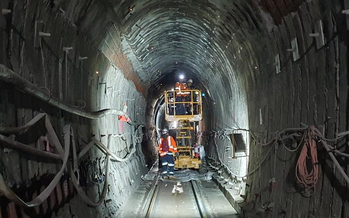 Tunnel 2, about 15km north of Helensville on the North Auckland Line, has the least clearance of any of the 100 tunnels on the KiwiRail network. Here, workers are re-profiling the lining to enable hi-cube containers on wagons to pass through.