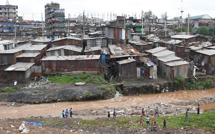 Children play next to Nairobi river in the Mathare valley slum in Nairobi, Kenya. File photo