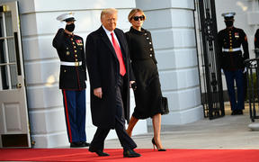 Donald Trump and First Lady Melania make their way to board Marine One, leaving the White House for the final time.