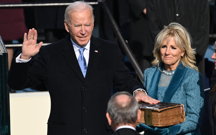 Joe Biden, alongside incoming US First Lady Jill Biden, is sworn in as the 46th US President by Supreme Court Chief Justice John Roberts.