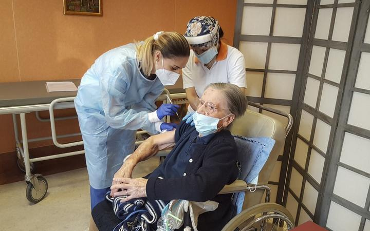 Italian healthcare Kos Group, shows the vaccination of 108-years-old Fatima Negrini, a resident at the group's Anni Azzurri San Faustino residence in Milan who tested positive in May 2020,  in Milan.