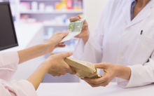 Some pharmacies are charging consumers 20 cents to $1 more per prescription than their contract entitles them to.
