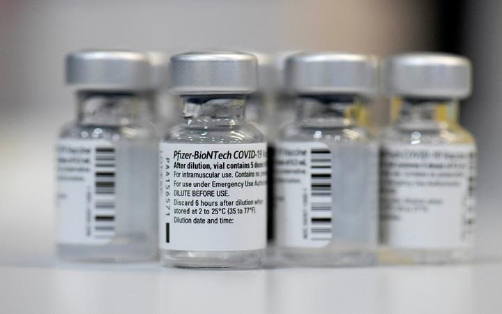 Empty vials of the Pfizer-BioNTech Covid-19 disease vaccine are displayed at the regional corona vaccination centre in Ludwigsburg, southern Germany, on January 22, 2021.