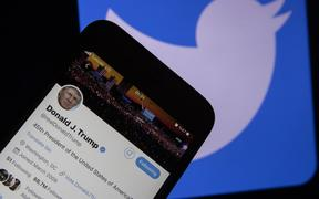 ANKARA, TURKEY - JANUARY 7: In this photo illustration, smart phone screen shows twitter account of U.S. President Donald Trump and a computer screen displaying the logo of Twitter are seen in Ankara, Turkey on January 7, 2021. Ercin Erturk / Anadolu Agency