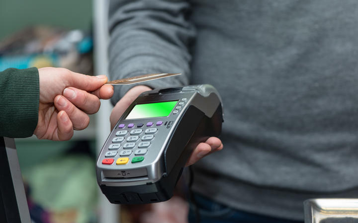 NFC technology, customer do payment with contactless credit card. Credit card reader implements payment execution, in the shop