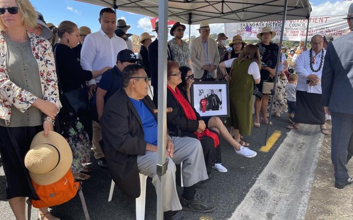 Whānau of Rudy Taylor hold a photo of the late Ngāpuhi leader as they wait to be welcomed on to Te Tii marae.
