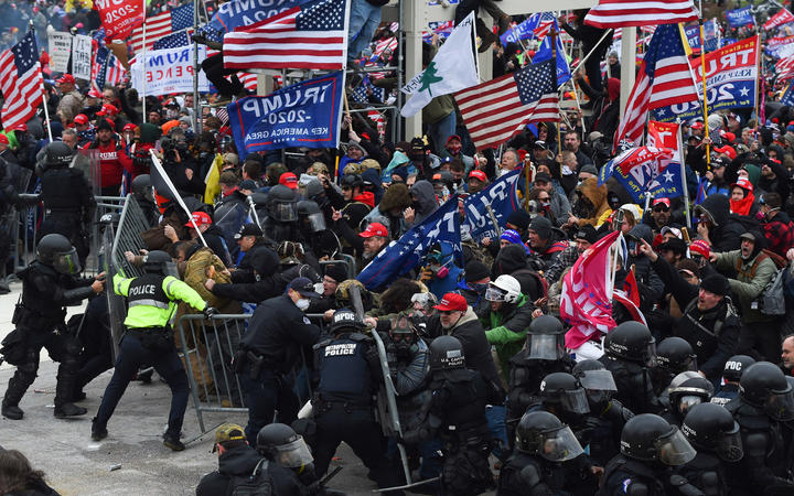 Trump supporters clash with police and security forces at the US Capitol on 6 January 2021.