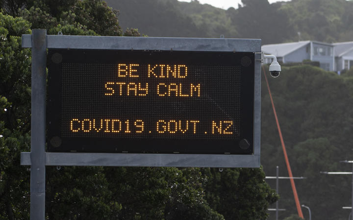 A motorway sign reads