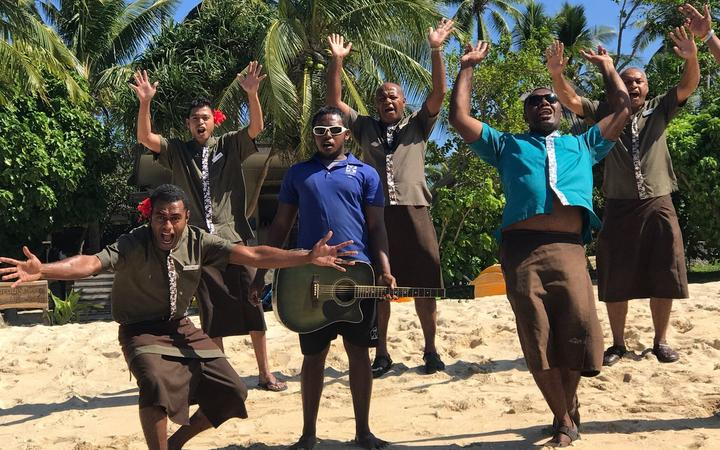 Tourism staff in Fiji greet visitors to their resort in the Yasawa Islands