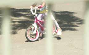 A child on a bike at an emergency accommodation motel.