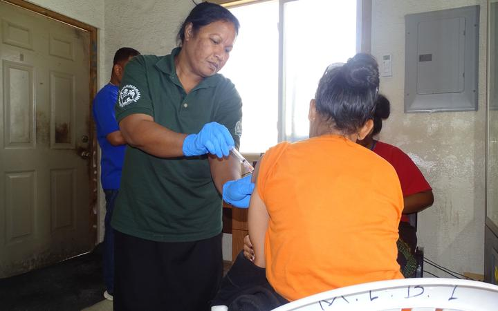 Public Health nurse Ruth Andrew administers a Covid vaccine shot in Majuro during a house-to-house outreach program to distribute vaccines.