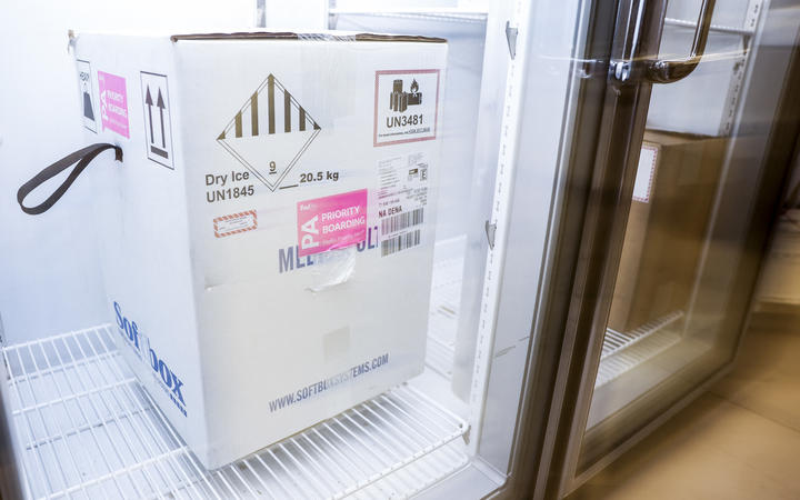 A box containing a shipment of the Pfizer-BioNTech Covid-19 vaccine sits in a freezer at a Colorado medical centre.