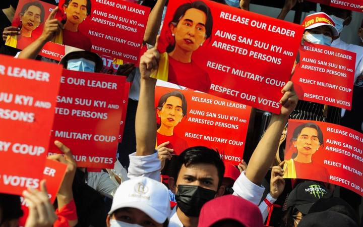 YANGON, MYANMAR - FEBRUARY 20: Anti-coup protesters hold placards as they protest against the military coup Saturday, February 20, 2021, in Yangon, Myanmar. Stringer / Anadolu Agency