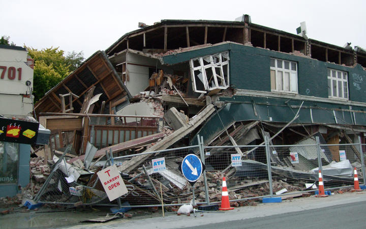 A photo taken on February 22, 2011 shows a collapsed row of shops on Worcester Street in Christchurch.