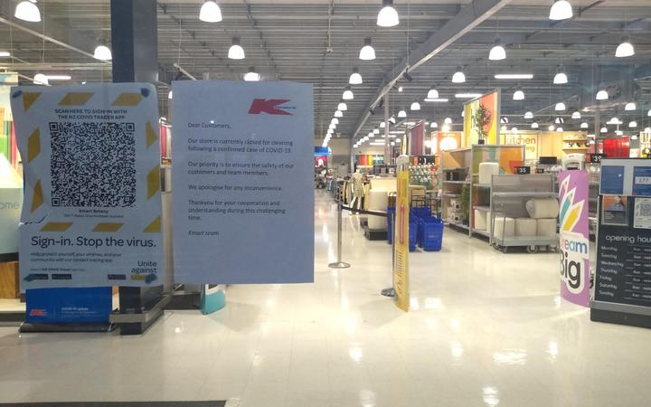 A sign on the door of Kmart Botany notifies customers the store is closed for cleaning due to a Covid-19 case.