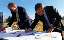 Housing Minister Nick Smith and Fletcher Building CEO Steven Evans sign the contract to build 196 homes on Moire Rd.