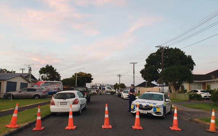 A cordon in Papatoetoe after a man was shot by police.