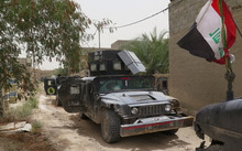 Iraqi counter terrorism force vehicles parked on a street in Falluja on 16 June 2016.