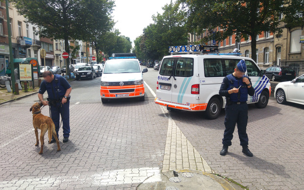 A picture taken on 17 June 2016 showing Belgian police officers standing guard in the district of Etterbeek, in Brussels.