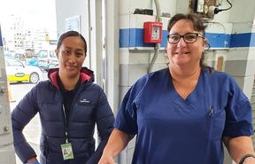 Hospital Security person Irene and registered nurse Wendy Thompson deliver the first of the COVID-19 vaccines to the Sulphur Point.