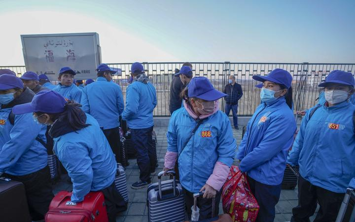 Buzeynep Abulehet (second from right) arrives at Fuhai County by train, in northwest China's Xinjiang Uygur Autonomous Region, March 28, 2020.