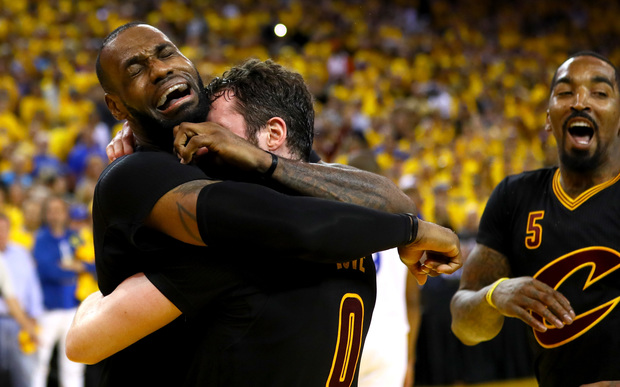 LeBron James and Kevin Love of the Cleveland Cavaliers celebrate after defeating the Golden State Warriors in the NBA final on 20 June 2016.