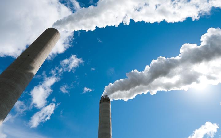 14596413 - smoking industrial chimneys against a blue sky