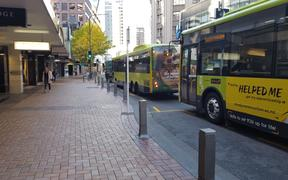 Largely empty buses on Wellington's Lambton Quay on the first day of level 3, 28 April