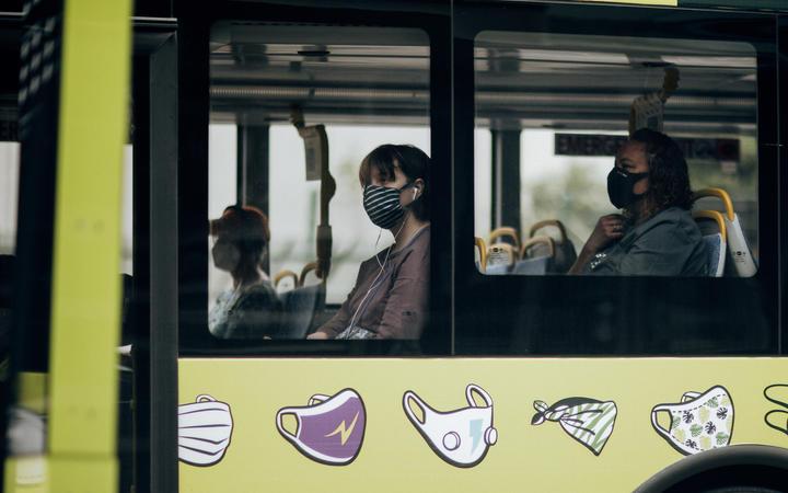 Bus passengers wearing masks during level 2, Wellington 15 February 2021
