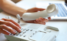A person dials a number on a home landline phone (file)