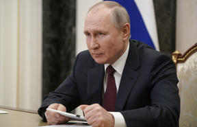 Russian President Vladimir Putin attends a meeting on social and economic development of Crimea and Sevastopol, via teleconference call, at the Kremlin in Moscow, Russia.