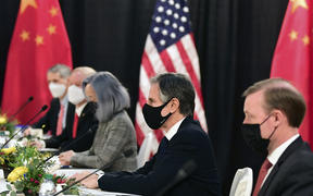 The US delegation led by Secretary of State Antony Blinken, flanked by US National Security Advisor Jake Sullivan , face their Chinese counterparts at the opening session of US-China talks at the Captain Cook Hotel in Anchorage, Alaska.