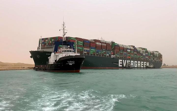 An image released by the Suez Canal Authority on 24 March 2021 shows 400m long container ship lodged sideways and impeding traffic across Egypt's Suez Canal.