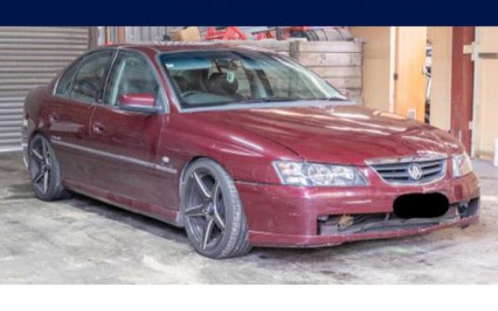 An image of the maroon Holden Commodore police are seeking sightings of.
