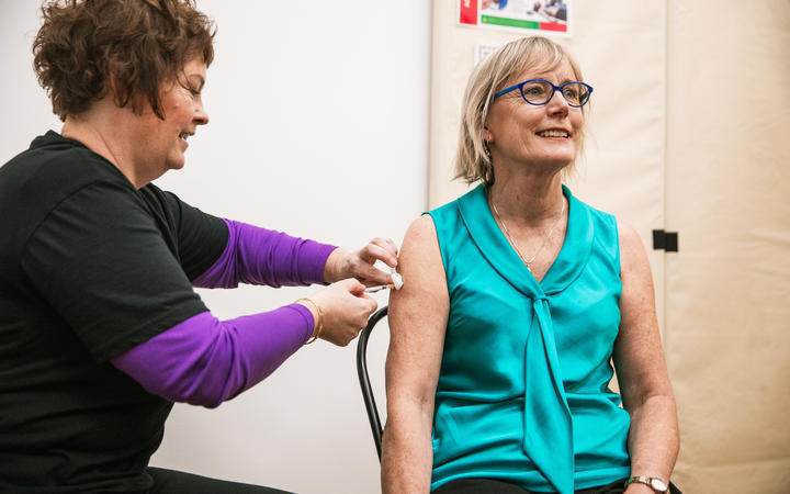 Immunisation Advisory Centre (IMAC) Director, Nikki Turner receiving her COVID-19 vaccination