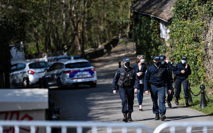 Police officers cordoned off an area near the house of French businessman Bernard Tapie and his wife Dominique Tapie in Combs-la-Ville, southeastern suburbs of Paris.