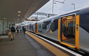 The first Te Huia commuter train from Hamilton to Auckland arrives at Papakura on Tuesday morning.